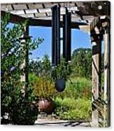 Wind Chime In A Garden Acrylic Print by Mandy Judson