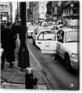 Yellow Cab On Taxi Rank Outside Madison Square Garden On 7th Avenue New York City Usa Acrylic Print by Joe Fox