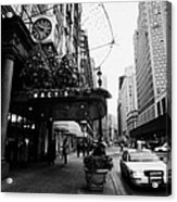 yellow taxi cab waits outside entrance to Macys department store on Broadway and 34th street Acrylic Print by Joe Fox