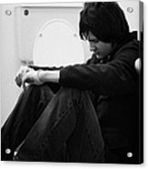 Young Dark Haired Teenage Man Sitting On The Floor Of The Bathroom With Back Against The Wall In The Acrylic Print by Joe Fox