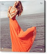 Young Woman In Orange Dress Flying In The Wind At Sea Shore Acrylic Print by Oleksiy Maksymenko