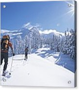 Cross-country Skiers In The Selkirk Acrylic Print by Jimmy Chin