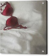 Red Brassiere Laying On Bed Acrylic Print by Sandra Cunningham