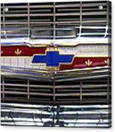 1956 Chevrolet Grill Emblem Acrylic Print by Mike McGlothlen