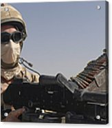 A British Army Soldier Mans A Machine Acrylic Print by Andrew Chittock