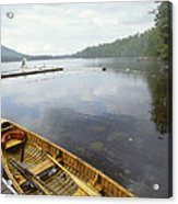 A Canoe Floats Next To A Dock Acrylic Print by Skip Brown