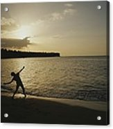 A Child, Silhouetted At Sunset, Throws Acrylic Print by Raul Touzon