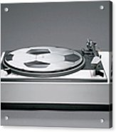 A Disk With A Soccer Print On A Record Player Acrylic Print by Benne Ochs