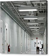 A Long Corridor In A Residential Unit Acrylic Print by Roberto Westbrook