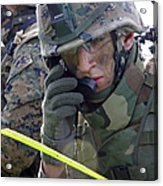 A Marine Communicates Over The Radio Acrylic Print by Stocktrek Images