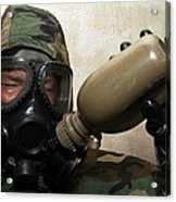 A Marine Drinks Water From A Canteen Acrylic Print by Stocktrek Images