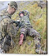 A Patrol Medic Applies First Aid Acrylic Print by Andrew Chittock