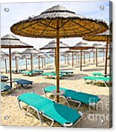 Beach Umbrellas On Sandy Seashore Acrylic Print by Elena Elisseeva