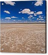 Clouds Float In A Blue Sky Above A Dry Acrylic Print by Jason Edwards