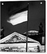 german flag flying fluttering on flagpole outside reichstag building Berlin Germany Acrylic Print by Joe Fox