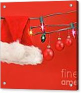 Hanging Lights With Santa Hat Acrylic Print by Sandra Cunningham