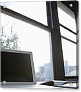 Laptop On A Desk Acrylic Print by Jetta Productions, Inc