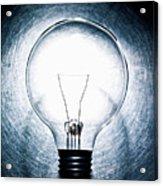 Light Bulb On Stainless Steel Background. Acrylic Print by Ballyscanlon