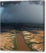 Monsoon Rains Over A Muddy River Acrylic Print by Randy Olson
