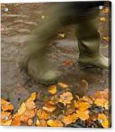 Person In Motion Walks Through Puddle Acrylic Print by John Short