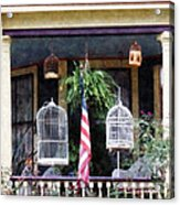 Porch With Bird Cages Acrylic Print by Susan Savad