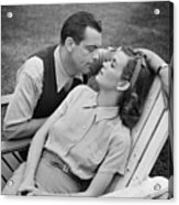 Romantic Couple Relaxing On Deckchair, (b&w) Acrylic Print by George Marks