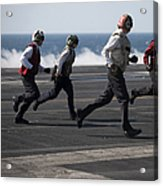 Sailors Clear The Landing Area Acrylic Print by Stocktrek Images