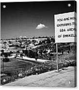 sign overlooking pyla and turkish controlled territory marking entrance of SBA Sovereign Base area Acrylic Print by Joe Fox