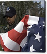 Soldier Unfurls A New Flag For Posting Acrylic Print by Stocktrek Images