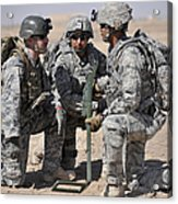 Soldiers Discuss A Strategic Plane Acrylic Print by Stocktrek Images