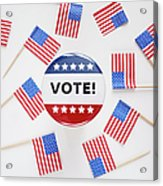 Studio Shot Of Vote Pin And Small American Flags Acrylic Print by Winslow Productions