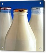 Tops Of Three Types Of Bottled Milk Acrylic Print by Steve Horrell