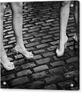 Two Young Women Wearing High Heeled Shoes And Fake Tan On Cobblestones On A Night Out In Dublin  Acrylic Print by Joe Fox