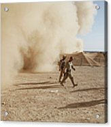 U.s. Marines Walk Away From A Dust Acrylic Print by Stocktrek Images