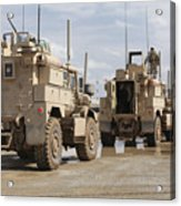 A Convoy Of Mrap Vehicles Near Camp Acrylic Print by Stocktrek Images