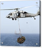 A Mh-60 Helicopter Transfers Cargo Acrylic Print by Gert Kromhout