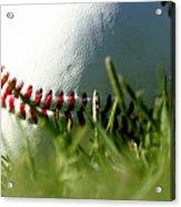 Baseball In Grass Acrylic Print by Chris Brannen
