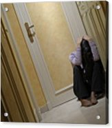 Depressed Woman Sitting In Corridor With Head In Hands Acrylic Print by Sami Sarkis
