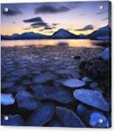 Ice Flakes Drifting Against The Sunset Acrylic Print by Arild Heitmann