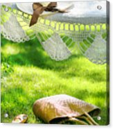 Straw Hat With Brown Ribbon Laying On Hammock Acrylic Print by Sandra Cunningham