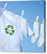T-shirt With Recycle Logo Drying On Clothesline On A  Summer Day Acrylic Print by Sandra Cunningham