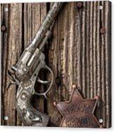 Toy Gun And Ranger Badge Acrylic Print by Garry Gay