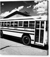 yellow american bluebird school bus in Lynchburg tennessee usa Acrylic Print by Joe Fox
