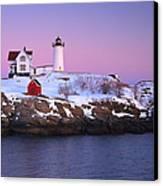 Nubble Light Under A Pastel Winter Sky Canvas Print by Jeff Sinon