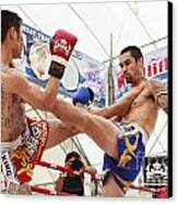 Thai Boxing Match Canvas Print by Anek Suwannaphoom