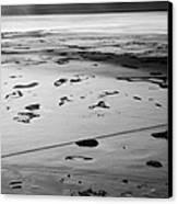 aerial view of snow covered prairies and remote isolated farmland in Saskatchewan Canada Canvas Print by Joe Fox