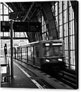 Berlin S-bahn Train Speeds Past Platform At Alexanderplatz Main Train Station Germany Canvas Print by Joe Fox