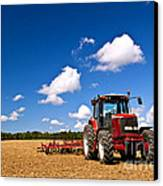 Tractor In Plowed Field Canvas Print by Elena Elisseeva