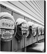 snow covered electricity meters in Saskatoon Saskatchewan Canada Canvas Print by Joe Fox