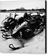 snowmobiles parked in Kamsack Saskatchewan Canada Canvas Print by Joe Fox